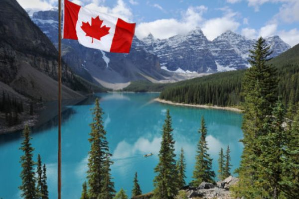 The Canadian National flag set against the Rocky Mountains of Banff National Park  Canada