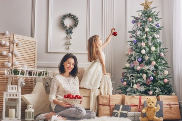 mom-and-daughter-decorate-the-christmas-tree-P9258YS